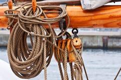 Ropes on  tallship mast close-up. Ropes on tallship cleat close-up Stock Photography