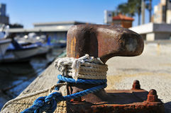 Ropes tied on a rusty mooring Royalty Free Stock Image
