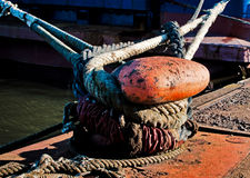 Ropes tied to the dock Royalty Free Stock Images