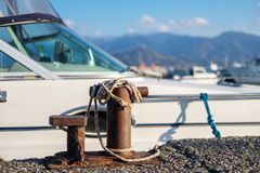 Free Ropes Tied To The Small Steel Anchoring Bollard Stock Photos - 167493913