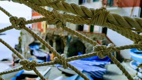 Ropes in waterfront port city royalty free stock photos