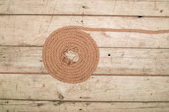 Ropes on a wooden background Royalty Free Stock Images