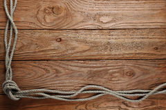 Ropes on a wooden background Stock Photos