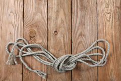 Ropes on a wooden background Royalty Free Stock Photography