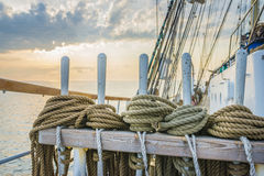 Ropes and wooden pulley in an old yacht. Ropes on an old yacht Royalty Free Stock Photography