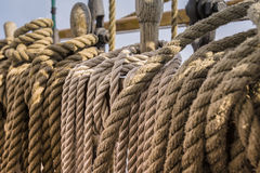 Ropes and wooden pulley in an old yacht. Sunset Royalty Free Stock Image