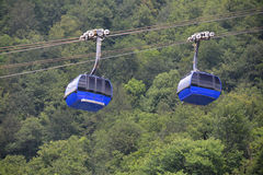 Ropeway cabins. Two ropeway cabins lifting in summer Royalty Free Stock Photography