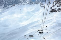 Ropeway or cable car station in the ski area of the zugspitze, the highest mountain in germany in the bavarian alps, copy space. Ropeway or cable car station in stock image