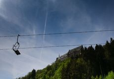 Ropeway in front of a castle royalty free stock images