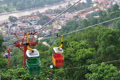 Ropeway In Haridwar. Mansa Devi Temple can be reached in two ways: on foot or by cable car. Walking requires a one and a half kilometer hike uphill. The track Royalty Free Stock Photo