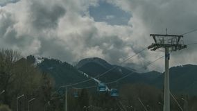 Ropeway lifting skiers to mountain stock video footage