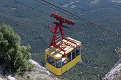 Ropeway in mountains Stock Images