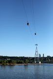 Ropeway in the city across the river Royalty Free Stock Images