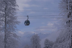 A ropeway over the trees. In a cloudy day Stock Photo