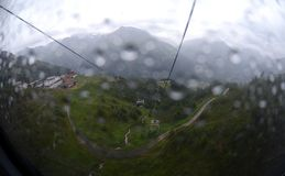 Ropeway in the rain Royalty Free Stock Image