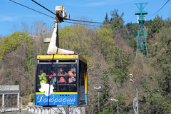 Ropeway. SOCHI, RUSSIA - MAR 23, 2014: People get up in the cradle cable car to the top part of the Sochi arboretum Royalty Free Stock Image