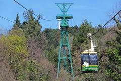 Ropeway. SOCHI, RUSSIA - MAR 23, 2014: People get up in the cradle cable car to the top part of the Sochi arboretum Royalty Free Stock Photography