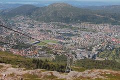 Ropeway Ulriksbanen and city at mountain foot. Bergen, Norway. 10-07-2018 Royalty Free Stock Photos