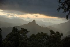 Roque Bentayga Monolith in Gran Canaria. At sunset with fog Royalty Free Stock Photo