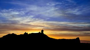 Colorful sky on natural park Roque Nublo at sunset, Gran canaria Royalty Free Stock Images