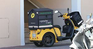 Yellow Postal Delivery Staby Electric Scooter In France. Roquebrune-Cap-Martin, France - April 30, 2019: Yellow Postal Delivery Ligier Staby Pulse 3 Wheel stock video