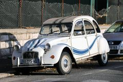 White And Blue Striped Citroen 2 CV. Roquebrune-Cap-Martin, France - December 4, 2018: White And Blue Striped Old Car Citroen 2 CV Parked On The Street, French royalty free stock image