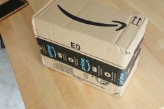 Amazon Prime Package Box Delivery. Roquebrune-Cap-Martin, France, September 5, 2018: Amazon Package Box Cardboard Delivery From Amazon Prime, Close Up View royalty free stock photo