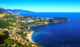 Roquebrune Cap Martin and its lovely Golfe Bleu beach. Elevated image taken of the main beach in this area, and also showing the Italian Riviera and its Stock Photo