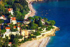 Roquebrune Cap Martin mansions and beaches. High altitude photograph of incredibly luxurious mansions located directly on the beach Stock Images