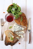 Roquefort blue cheese and wineglass Stock Images