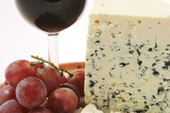 Roquefort cheese and grapes Stock Photos