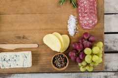 Roquefort cheese, grapes and ham with various ingredients on chopping board. Close-up of roquefort cheese, grapes and ham with various ingredients on chopping Royalty Free Stock Image