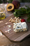 Roquefort cheese with indian nuts Stock Photos