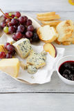 Roquefort cheese with jam and grapes Royalty Free Stock Images