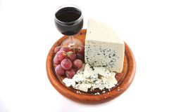 Roquefort cheese and wine glass Stock Image