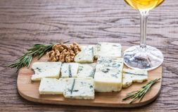 Roquefort with glass of white wine on the wooden board Stock Photos