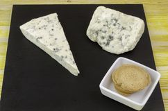 Roquefort and gornozola over slate plate. Stock Image