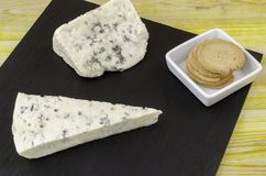 Roquefort and gornozola over slate plate. Royalty Free Stock Image