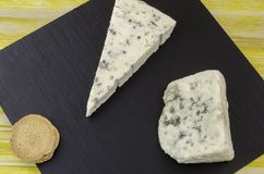 Roquefort and gornozola over slate plate. Royalty Free Stock Photography