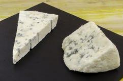 Roquefort and gornozola over slate plate. Stock Photos