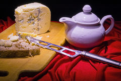 Roquefort and white teapot Royalty Free Stock Photo