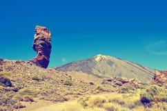 Roques de Garcia and Pico del Teide mountain volcano in the background. Roque Cinchado in El Teide National park. Royalty Free Stock Photos