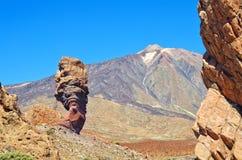 Roques de Garcia and Pico del Teide mountain volcano in the background. Roque Cinchado in El Teide National park. Royalty Free Stock Image