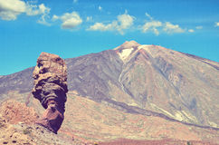 Roques de Garcia and Pico del Teide mountain volcano in the background. Roque Cinchado in El Teide National park. Royalty Free Stock Photography