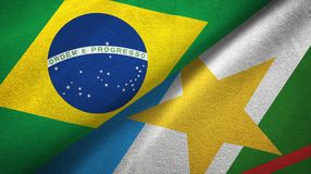 Roraima state and Brazil flags textile cloth, fabric texture. Roraima state and Brazil folded flags together stock illustration