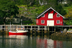 Rorbu and Boat at the Lofoten. Rorbu, Typical House and boat at the Lofoten in Norway Stock Photography