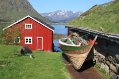 Rorbu, cabin and  old boat Stock Photos