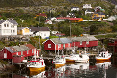 Rorbu and the fishermans ship Stock Photography
