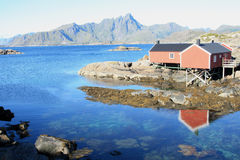 Rorbuer mirroring in  Mortsund. Traditional fisherman's cabins of the village of Mortsund in  Lofoten islands
