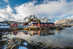 Rorbuer in Sund, Lofoten, Norway. Rorbuer reflected in water in Sund, Lofoten, Norway stock images